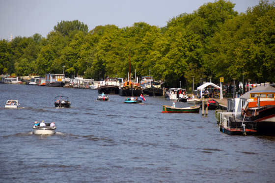 Boats along the Amstel River in Amsterdam