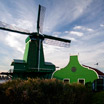 Colorfull green windmill at the popular attraction, Zaanse Schans